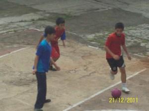Ahmad Sandi is dribbling Ball when against a team grade 7